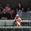 An Enid baseball enthusiast braves the heat of the son as others seek comfort in the shade during the Minors' game against the Southmoore Sabercats in the Connie Mack State Baseball Tournament at David Allen Memorial Ballpark Friday, July 19, 2013. (Staff Photo by BONNIE VCULEK)