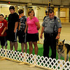 The Lamle family pauses with Enid Police Officer Justin Lamle and EPD Police Dog Thor during a special retirement ceremony for Thor at the 4th annual Paws 4 the Cause 2013 Dachshund Dash at the Chisholm Trail Coliseum Saturday, July 27, 2013. (Staff Photo by BONNIE VCULEK)