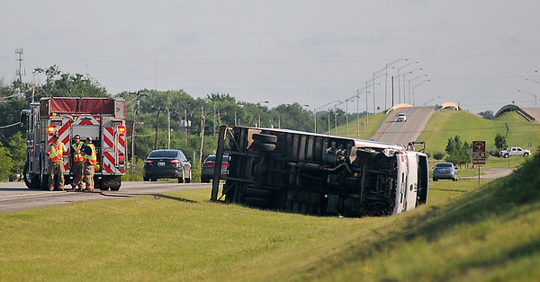 Enid Fire Department and Enid Police Department assist at a roll-over accident south of the S. Van Buren overpass on U.S. 81 early Wednesday, July 24, 2013. According to initial findings, the driver of the truck was dosing off behind the wheel, over-corrected, rolling the vehicle. The occupants kicked out the windshield before crawling to safety. Northbound traffic on U.S. 81 was limited to one lane by the Grayridge residential entrance past the scene until Enid Police completed their investigation. (Staff Photo by BONNIE VCULEK)