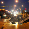 A Jeep rest on its top just west of the intersection of Oakwood and Garriott Monday evening after being involved in a two-vehicle accident. (Staff Photo by BILLY HEFTON)
