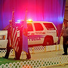 Enid Police Department Honor Guard posts the colors as Officers Justin Lamle and Thor process in for Officer Thor's retirement during the 4th annual Paws for the Cause 2013 Dachshund Dash at the Chisholm Trail Coliseum. Proceeds from the event fund the purchase of new K-9 police dogs. (Staff Photo by BONNIE VCULEK)