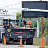 Technicians work on an electronic message sign on Southgate Rd. Tuesday near the entrance to Vance Air Force Base. The city of Enid, with assistance from Oklahoma Military Strategic Planning Commission, have installed this sign along with one on south Cleveland that will be operated by 71st Security Forces Squadron and will display updates on gate closures and other traffic-related announcements. (Staff Photo by BILLY HEFTON)