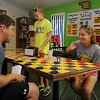 Brent Price (left) and his daughter, Madison, play a game of checkers as the Price family spends the morning relaxing at Putt Putt Golf, 710 Overland Trail. After a couple games of miniature golf and indoor games, the family biked the Enid Trails to several Enid parks during their family outing. (Staff Photo by BONNIE VCULEK)