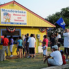 Families wait in line at the Meadowlake Miniature Golf and Sno Cones for snacks before the annual fireworks festivities Thursday, July 4, 2013. (Staff Photo by BONNIE VCULEK)