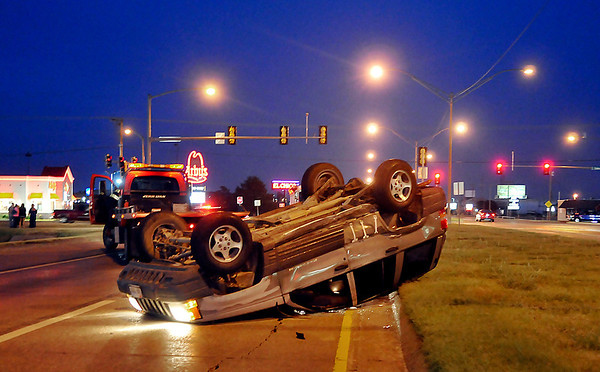 A Jeep rest on it's top just west of the intersection of Oakwood and Garriott Monday evening after being involved in a two vehicle accident. (Staff Photo by BILLY HEFTON)