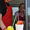 Shelbi Fore and Kanima Hammons service sweet treats at E-Town Ice near the corner of Oakwood Road and King Tuesday, July 9, 2013. The new business opened Tuesday, July 2. (Staff Photo by BONNIE VCULEK)