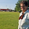 As traffic flows west on Owen K. Garriott, Connie Sturgeon-Hart stands in the lot where her new Chick-fil-A business will be located. The store will be between My Dentist and Jackson's of Enid. Hart's business has been in the Oakwood Mall food court for the last 26 years. (Staff Photo by BONNIE VCULEK)