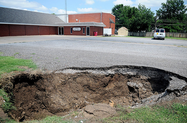 After a smaller sink hole was repaired at Bethel Baptist Church and Academy earlier this year, a much larger one has appeared near Cleveland Tuesday, July 30, 2013. (Staff Photo by BONNIE VCULEK)