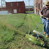 """David Nicholson mows the back lot of Garfield Furniture with his restored 50-year-old Lawn Boy 21"""" cut mower Monday, July 1, 2013. The mower, which sold in Otasco stores across the nation in 1963 for $125, features a two-cycle 4-horsepower engine with finger tip start. (Staff Photo by BONNIE VCULEK)"""