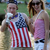 Wyatt Nirider and Chelsea Callant show their patriotic spirit as they celebrate the Fourth of July at Meadowlake Park with friends Thursday, July 4, 2013. (Staff Photo by BONNIE VCULEK)