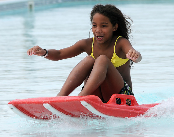 Ealiyah Lewis rides the waves of Splash Zone's Drop Zone Tuesday, July 2, 2013. (Staff Photo by BONNIE VCULEK)