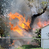 Enid firefighters battle a shed fire at 615 E. Broadway Monday, July 1, 2013. (Staff Photo by BONNIE VCULEK)