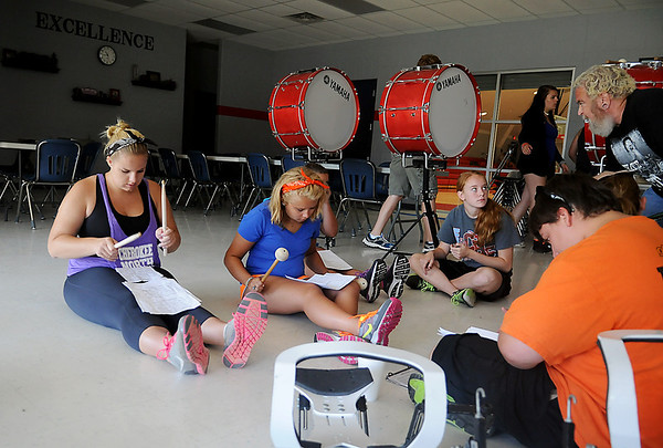 Tim Copeland (top, right) instructs the Chisholm High School drum line during band camp at the Chisholm Wednesday, July 24, 2013. Camp participants begin each day at 8 a.m. with field marching, then rehearse musical selections for their fall band performances. (Staff Photo by BONNIE VCULEK)