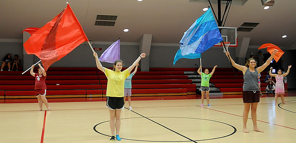 Chisholm High School color guard learn a new routine during band camp Wednesday, July 24, 2013. (Staff Photo by BONNIE VCULEK)