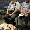 Ralph Haney's seeing-eye dog rests near him as concerned citizens listen to James Neal, general manager of the Enid Public Transit Authority, explain the proposed changes in the EPTA operations, services and fare rates during a public forum at the City of Enid Commission Chambers Wednesday, July 10, 2013. Neal and Mark Anzalone, the marketing/advertising director for the EPTA, answered questions during the discussion. (Staff Photo by BONNIE VCULEK)