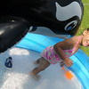 Cameron Dean, 3-year-old daughter of Marissa Bell and David Dean from Enid, plays in her private kiddie pool as she cools off Tuesday, July 23, 2013. Dean looks forward to her daily swims and tea parties. (Staff Photo by BONNIE VCULEK)