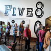 Customers line up out the door of Five80 Coffee at Forgotten Ministries' grand opening of their new location at 120 E. Randolph during First Friday festivities in downtown Enid Friday, July 5, 2013. (Staff Photo by BONNIE VCULEK)
