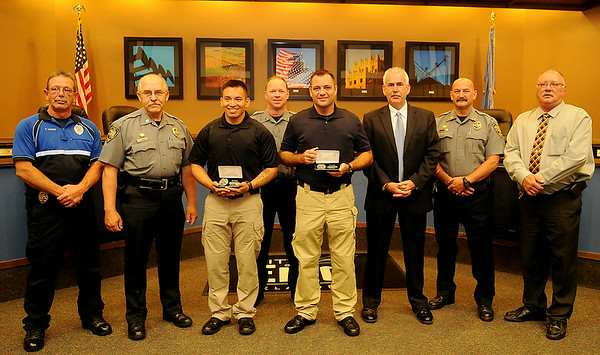 Enid Police Department Officers pause for a portrait with new officers Jesse Hernandez and Nicholas Shackleford (front center) during a special ceremony in the city of Enid Commission Chambers. (Staff Photo by BONNIE VCULEK)