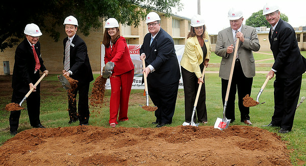 Dr. Cheryl Evans (third from left), President of Northern Oklahoma College, and Dr. Glen Johnson (center), Chancellor for the Oklahoma State System of Higher Education, and NOC Board of Regent members break ground for the new NOC Enid Residence Hall Wednesday, July 16, 2014. (Staff Photo by BONNIE VCULEK)