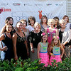 Models and guests pause on the Etown Fashion Week red carpet outside Maple Place Bed & Breakfast Monday, July 7, 2014. Proceeds from the week-long events support Loaves & Fishes, the Northwest Oklahoma Regional Food Bank in Enid. (Staff Photo by BONNIE VCULEK)