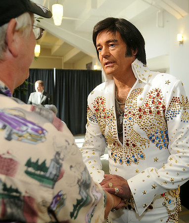 Elvis, performed by Marshall Matthews, welcomes Nikki Hamm to his concert at the Enid Event Center and Convention Hall during a special VIP meal Saturday, July 12, 2014. (Staff Photo by BONNIE VCULEK)