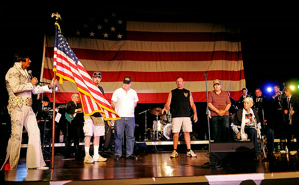 "International Elvis Entertainer Marshall Matthews and The Memphis Kings perform ""The American Trilogy"" as they honor American Veterans at Enid Event Center and Convention Hall Saturday, July 12, 2014. (Staff Photo by BONNIE VCULEK)"