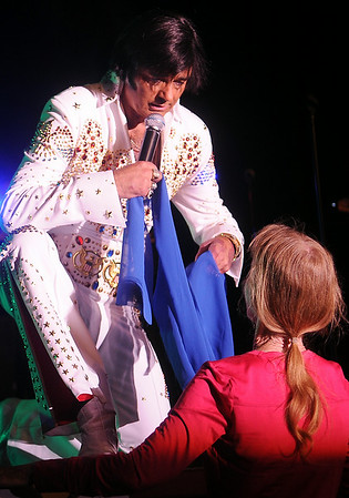 "International Elvis Entertainer Marshall Matthews places a scarf around a fan's neck as he sings ""Love Me Tender"" at Enid Event Center and Convention Hall Saturday, July 12, 2014. (Staff Photo by BONNIE VCULEK)"