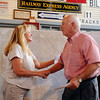 Connie Blankenship (left) presents two checks totaling $15,000 to Doug Frantz during the Woodring Wall of Honor presentations at the Railroad Museum of Oklahoma Wednesdady, July 9, 2014. The donation, along with $7,500 from the Union Pacific Railroad Foundation will be used for the new Woodring Wall of Honor and Veterans Park education center at Enid Woodring Regional Airport. (Staff Photo by BONNIE VCULEK)