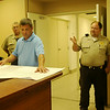 A contractor (center) reviews renovation blueprints as Garfield County Sheriff Jerry Niles and John Merz, with Corbin & Merz Architects, discuss the renovation of the Garfield County Public Safety Building at the Garfield County Fairgrounds Wednesday, July 16, 2014. (Staff Photo by BONNIE VCULEK)