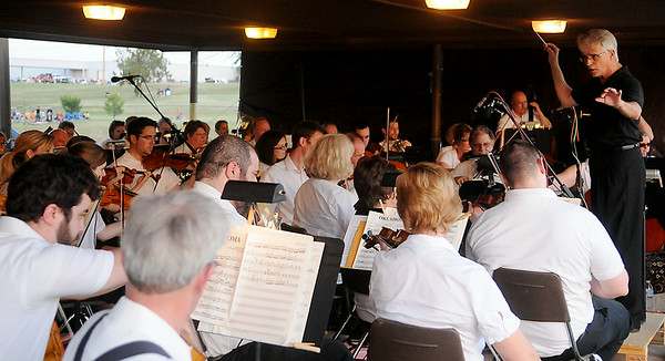 Enid Symphony Orchestra performs during the Fourth of July fireworks extravaganza at Meadowlake Park Friday, July 4, 2014. (Staff Photo by BONNIE VCULEK)