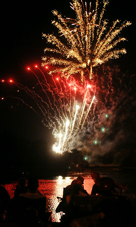 Fireworks reflect in the lake at Meadowlake Park during the annual Fourth of July fireworks extravaganza Friday, July 4, 2014. (Staff Photo by BONNIE VCULEK)
