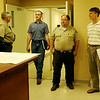 Garfield County Sheriff Jerry Niles (second from right) and John Merz (far right) tour the new location for the sheriff's office on the Garfield County Fairgrounds Wednesday, July 16, 2014. The Garfield County Public Safety Building renovation should be completed by September. (Staff Photo by BONNIE VCULEK)