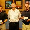 Enid Mayor Bill Shewey (center) pauses for a portrait with new Enid Police Officers Jesse Hernandez (left) and Nicholas Shackleford (right) during a special swearing in ceremony in the city of Enid Commission Chambers Thursday, July 10, 2014. (Staff Photo by BONNIE VCULEK)