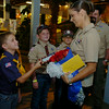 U.S. Navy Cryptologic Technician Collection Second Class Kimberly Henry (front right), receives recognition from Cub Scout Pack 3's Nathaniel Henry, Nathan Sullivan, Sam Akin and Pack Leaker Evan Sullivan at Leonardo's Children's Museum Friday, July 25, 2014. CTR2 Henry was honored for her service and volunteering more than 830 hours in search and rescue efforts of Operation Tomodachi after the Japan tsunami. (Staff Photo by BONNIE VCULEK)