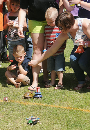 Guests watch the turtle race during Hometown Celebration at Adventure Quest Friday, July 4, 2014. (Staff Photo by BONNIE VCULEK)
