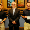 Enid Police Chief Brian O'Rourke (center) pauses for a portrait with new officers Jesse Hernandez (left) and Nicholas Shackleford (right) during a special swearing in ceremony at the city of Enid Commission Chambers Thursday, July 10, 2014. (Staff Photo by BONNIE VCULEK)