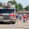 Enid Fire Department's Engine 5 leads the Wilderness Cove Neighborhood parade during a Fourth of July celebration Friday, July 4, 2014. (Staff Photo by BONNIE VCULEK)