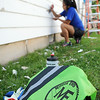 Daylyn Gunkel, from Stillwater, joins other volunteers as they scrape peeling paint on the exterior walls of a home at 2323 W. Broadway Tuesday, July 8, 2014. Over 200 volunteers from Christian Churches (Disciples of Christ), from across Oklahoma, will assist homeowners and businesses at 15 different locations during Mission Enid this week. (Staff Photo by BONNIE VCULEK)
