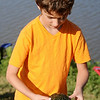 After catching three fish and releasing them, Hayden Wilson hooked a turtle during the annual Fourth of July fishing derby at Meadowlake Park Friday, July 4, 2014. (Staff Photo by BONNIE VCULEK)