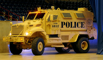 The new Enid SWAT Vehicle, a Navistar Maxx Pro Mine Resistant Ambush Protected (MRAP) awarded to the Enid Police Department through the U.S. Dept. of Defense grant program, arrives during the 5th annual Paws 4 the Cause Dachshund Dash at the Chisholm Trail Coliseum Saturday, July 19, 2014. (Staff Photo by BONNIE VCULEK)