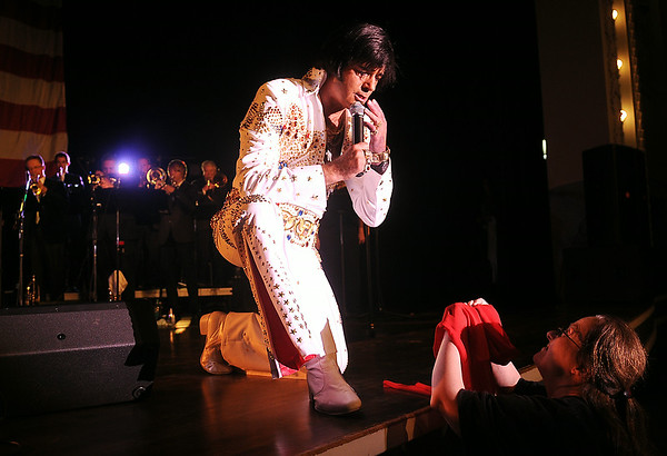 "International Elvis Entertainer Marshall Matthews (center) sings ""Are You Lonesome Tonight"" as he blows a kiss to Tamma at Enid Event Center and Convention Hall during the Marshall Matthews and The Memphis Kings Concert Saturday, July 12, 2014. (Staff Photo by BONNIE VCULEK)"