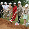 Dr. Cheryl Evans (center), President of Northern Oklahoma College, breaks ground for the new NOC Enid Residence Hall with NABHOLZ, Construction, Industrial, Civil and Environmental, and Frankfurt Short Bruza Architects, Engineers and Planners,Wednesday, July 16, 2014. (Staff Photo by BONNIE VCULEK)
