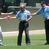 Umpires and players stay hydrated during the Connie Mack Regional Baseball Tournament at David Allen Memorial Ballpark Saturday, July 26, 2014. (Staff Photo by BONNIE VCULEK)
