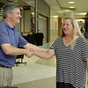 Jeff Funk, Enid News & Eagle Publisher, congratulates Ginger Cass after Cass won the trip to Branson during the One Grand Crazy Summer Giveaway at Oakwood Mall Saturday, July 26, 2014. (Staff Photo by BONNIE VCULEK)
