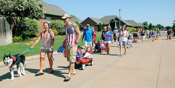 Residents in Wilderness Cove celebrate the Fourth of July during a patriotic parade around their neighborhood Friday, July 4,2014. (Staff Photo by BONNIE VCULEK)