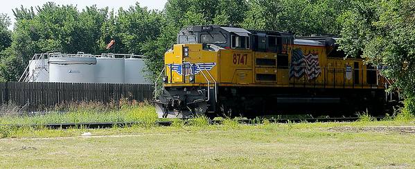 A Union Pacific locomotive pauses near E. Owen K. Garriott Saturday, July 5, 2014. (Staff Photo by BONNIE VCULEK)