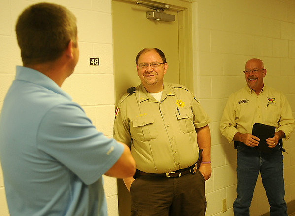 Garfield County Sheriff Jerry Niles (center) and Northwest Oklahoma Emergency Management director Mike Honigsberg (right) visit with a contractor during a walk-through of the offices at the Garfield County Public Safety Building on the Garfield County Fairgrounds Wednesday, July 16, 2014. The renovated facility should be completed in September. (Staff Photo by BONNIE VCULEK)