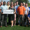 Enid Noon AMBUCS, 4RKids Board of Directors, Miracle League players and city of Enid officials join Tricia Mitchel at AMBUCS ABC Park as she receives a $15,000 donation from Brandon Morris, director of public affairs for the Union Pacific Railroad Foundation. The funds will assist with the rest of the park renovations for the 4RKids Miracle League. (Staff Photo by BONNIE VCULEK)