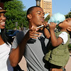 A family enjoys cotton candy during Maine Street Enid's Second First Friday in downtown Enid July 11, 2014. (Staff Photo by BONNIE VCULEK)