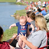 Little Sebastian Jordan gets his first fishing lesson during the annual Fourth of July fishing derby at Meadowlake Park Friday, July 4, 2014. (Staff Photo by BONNIE VCULEK)